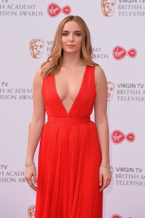 Actress Jodie Comer wore a beautiful red Alberta Ferretti gown with plunging neckline.
