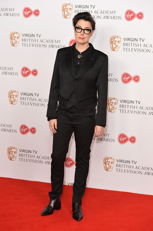 Host Sue Perkins looked slick in all black on the BAFTA TV red carpet.