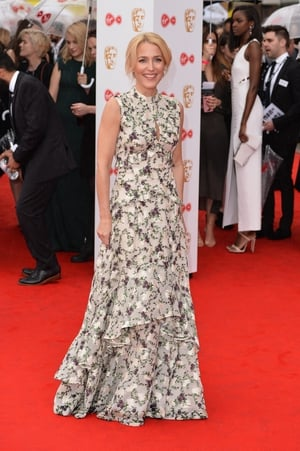 X-Files star Gillian Anderson wore a ruffled, floor length, Erdem gown.