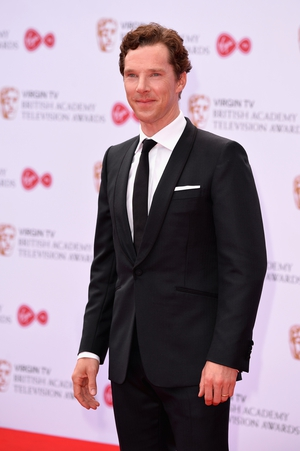 Benedict Cumberbatch looked smooth and suave in a simple black suit and tie.
