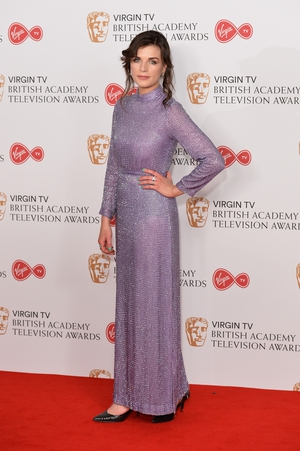 Irish actress Aisling Bea wore a vintage lilac dress.