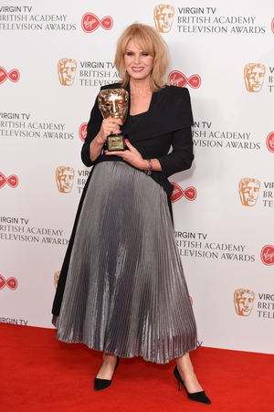 Joanna Lumley, winner of the Fellowship Award, wore a full-length, pleated, silver skirt that we all need in our wardrobes immediately.