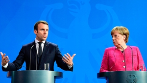 Emmanuel Macron and Angela Merkel urged their allies to speed up efforts to combat climate change