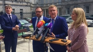 Michael McGrath (third from left) said garda controversies have destabilised the Government
