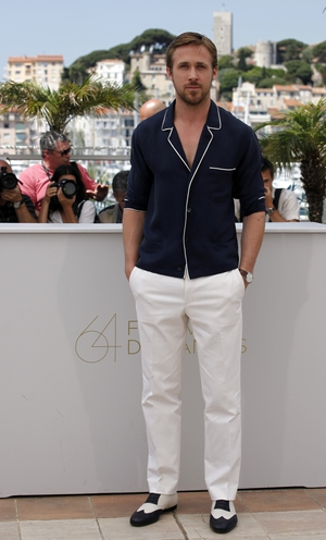 Ryan Gosling is always handsome even in a pajama-like Salvatore Ferragamo shirt here in 2011! We love how he matched the look with retro shoes.
