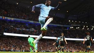Yaya Toure celebrates his side's third goal