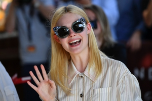 Day One - Wednesday May 17: Actress Elle Fanning arrived this morning wearing a fabulous pair of sunglasses. We need them for festival season.