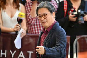 Day One - Wednesday May 17: South Korean director, writer, producer and member of jury Park Chan-Wook looking super classy this morning.