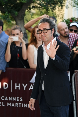 Day One - Wednesday May 17: Italian director, script writer and member of the jury Paolo Sorrentino has arrived to the red carpet looking very dapper.