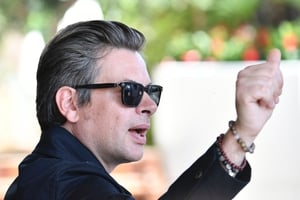 Day One - Wednesday May 17: French singer and songwriter Benjamin Biolay gives Cannes a thumbs up. We're loving those shades.