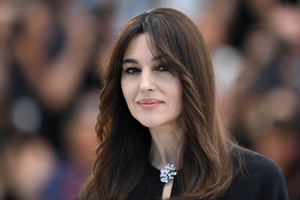 Day One - Wednesday May 17: Mistress of Ceremonies, Monica Bellucci looks beautiful as always with a stunning clasp and loose waves.