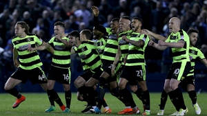Huddersfield Town players celebrate at the full-time whistle