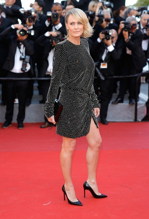 Day One - Wednesday May 17: Robin Wright shone in Saint Laurent! We are loving her hair flick.