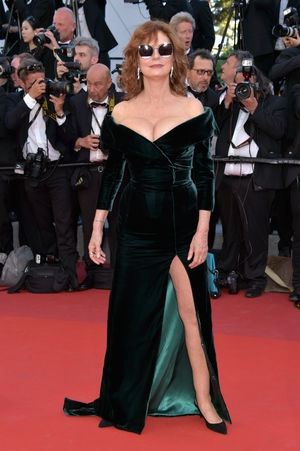 Day One - Wednesday May 17: The legendary Susan Sarandon rocked an Alberta Ferretti dress with Bardot neckline and thigh-high slit on the red carpet. We love her sunglasses - it is Cannes after all!
