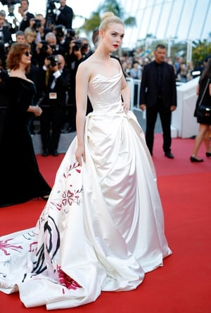 Day One - Wednesday May 17: Elle Fanning wore a magnificent Vivienne Westwood hand-painted unicorn (the actress' idea) gown on La Croisette's red carpet!