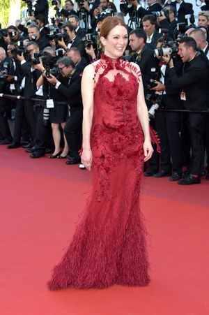 Day One - Wednesday May 17: Julianne Moore looked utterly beautiful in red in this Givenchy Couture floral gown.