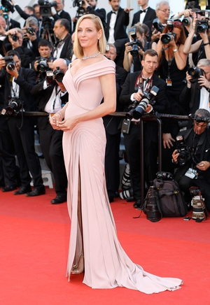 Day One - Wednesday May 17: The President of this year's 'Un Certain Regard' Jury, Uma Thurman, looks breathtaking in this pink powder Bardot gown! Can you spot the little daisies in her hands?