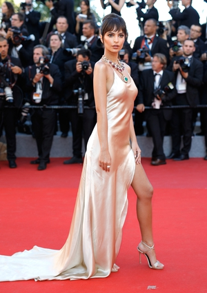 Day One - Wednesday May 17: Model Emily Ratajkowski looks like a Goddess in this silky floor length number. Check out those accessories!