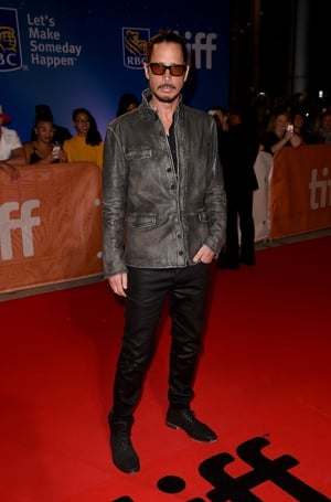 Chris Cornell attended the premiere of 'The Promise' at the 2016 Toronto International Film Festival wearing Bono-esque sunglasses and simple grey jacket.