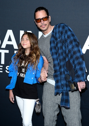 The fashionable Chris attends the Saint Laurent show at The Hollywood Palladium with his daughter Toni.