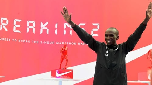 Eluid Kipchoge celebrates after his Breaking2 marathon attempt