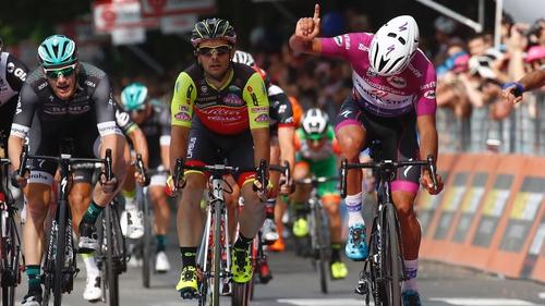 Fernando Gaviria surges to the line as Sam Bennett (L) finishes third in Reggio Emilia