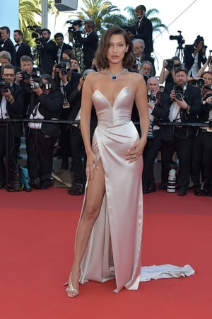 Day One - Wednesday May 17: The mesmerizing Bella Hadid obviously loves silk dresses for Cannes! Last year's look was red, but for year she chose a powder pink Alexandre Vauthier number. The thigh split is becoming her trademark look.