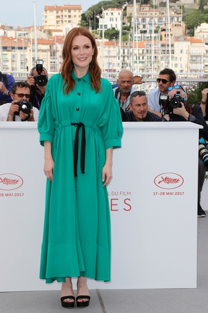 Day Two - Thursday May 18: Green is beautiful on the stylish Julianne Moore definitely has style. She may be a little lost though in this Sonia Rykiel shirt dress.