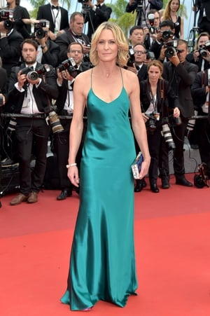 Day Two - Thursday May 18: Natural beauty Robin Wright looks exquisite in a simple turquoise slip dress.