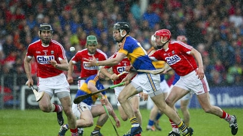 Tipperary's John McGrath under pressure from Cork's Lorcán McLoughlin in last year's Munster hurling clash between the counties
