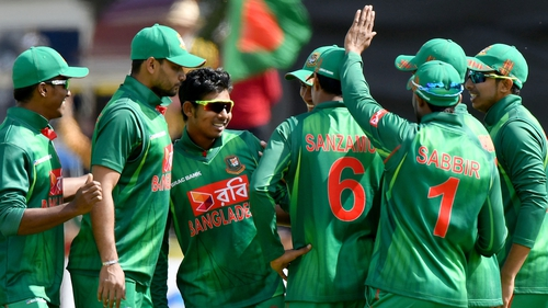 Bangladesh celebrate taking the wicket of William Porterfield