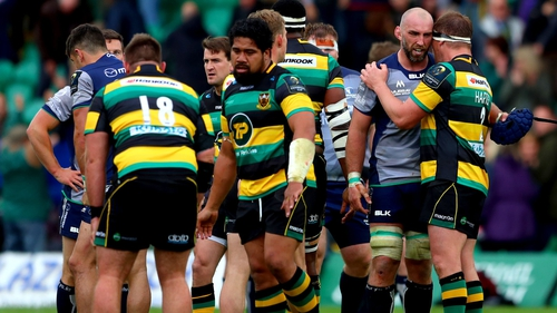 Northampton's Dylan Hartley consoles John Muldoon of Connacht after the game
