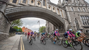 Riders pass through Christchurch Cathedral...