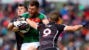 Sligo's Patrick O'Connor and Adrian McIntyre with Seamus O'Shea of Mayo