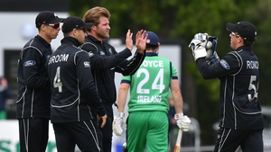 Corey Anderson of New Zealand is congratulated after dismissing Ed Joyce