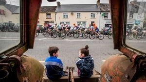 Luke and Caoimhe Conaty from Ballyjamesduff watch the riders pass through the village