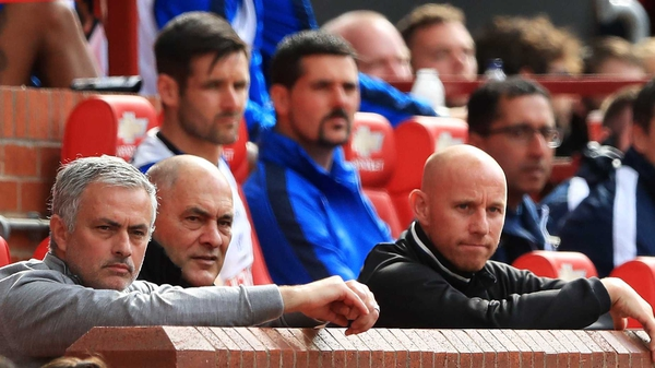 Jose Mourinho (L) watches his side beat Crystal Palace