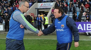 Managers Peter Creedon of Laois and Denis Connerton of Longford shake hands after the game