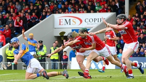 Tipperary's John McGrath lashes over a point despite the efforts of Cork's Colm Spillane, Mark Coleman and Damian Cahalane.