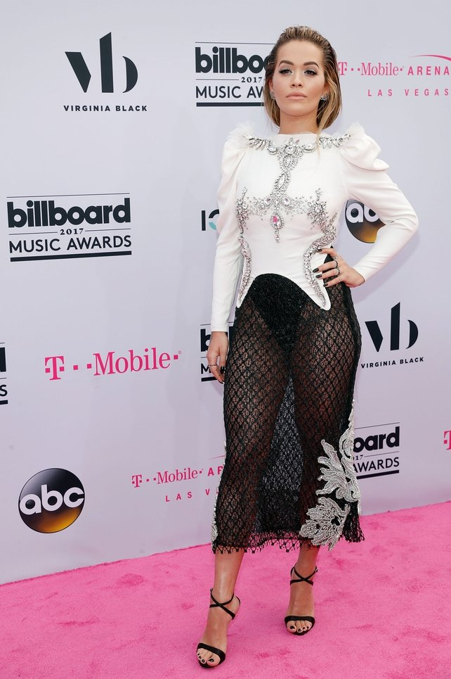 Rita Ora gave a shout out to Cher as an inspiration for her netted black skirt. The singer wore a Francesco Scognamiglio number with Giuseppe Zanotti shoes.