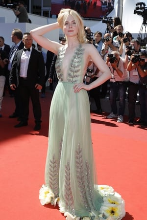 Day Five - Sunday May 21: Elle Fanning is a delicate flower in this wonderful Gucci gown! We love EVERYTHING about this dress!