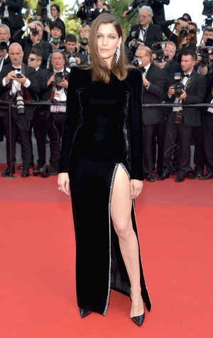 Day Five - Sunday May 21: French model Laetitia Casta is an effortless beauty in this Saint Laurent velvet gown! Seems like the thigh-high dress is a Cannes trend this year!