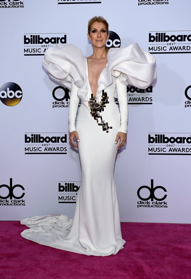 Singer Celine Dion wore a white, Haute Couture, Stephen Rolland gown with huge shoulder detail and Giuseppe Zanotti shoes.