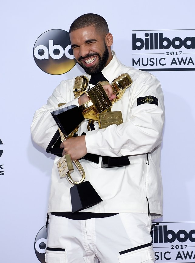 Wearing white and black, rapper Drake brought home gold at the Billboard Music Awards. The rapper won 13 awards in total on the night.
