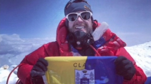 John Burke sits with his Clare flag at the top of Mount Everest last week
