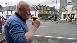 Peter Gill from Claremorris watches the Rás pass through the town