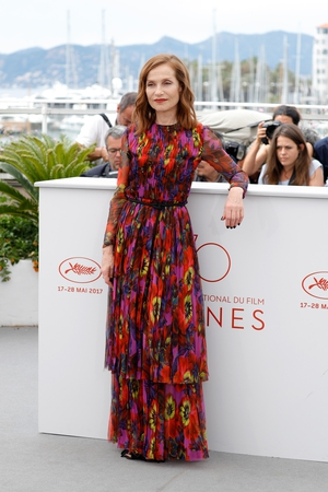 Day Six - Monday May 22: Oscar nominated French actress Isabelle Huppert is grace embodied. She gives us summer vibes in this Gucci floral dress.