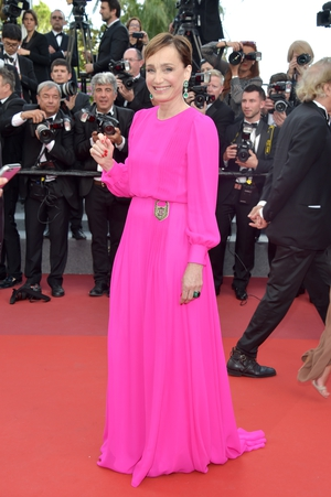 Day Six - Monday May 22: The timeless beauty of Kristin Scott Thomas is glorified by this fuchsia Schiaparelli gown. We love the glittery padlock detail of the dress.