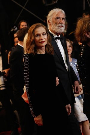 Day Six - Monday May 22: Isabelle Huppert returns to the red carpet looking stylish as ever in all black. She is accompanied by director Michael Haneke.