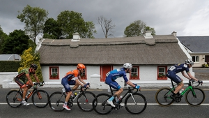 Thw riders pass by a thatched cottage outside of Ballysadare, Co Sligo
